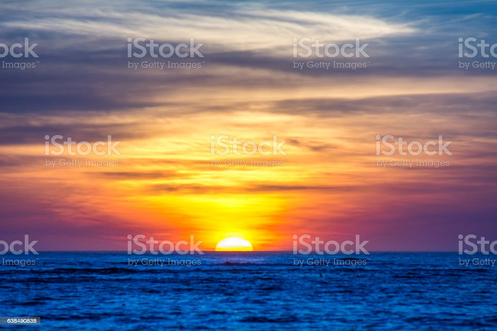 sunset above the sea stock photo