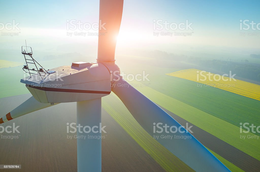 Sunset above the windmills on the field stock photo