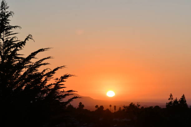 sunset across a valley - steven harrie stock photos and pictures