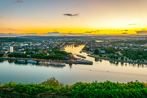 Sunset aerial view of confluence of Rhein and Mosel rivers in Koblenz, Germany