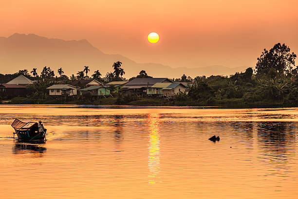 Sunset along river in Kuching, Borneo Sunset along the river in Kuching island of borneo stock pictures, royalty-free photos & images
