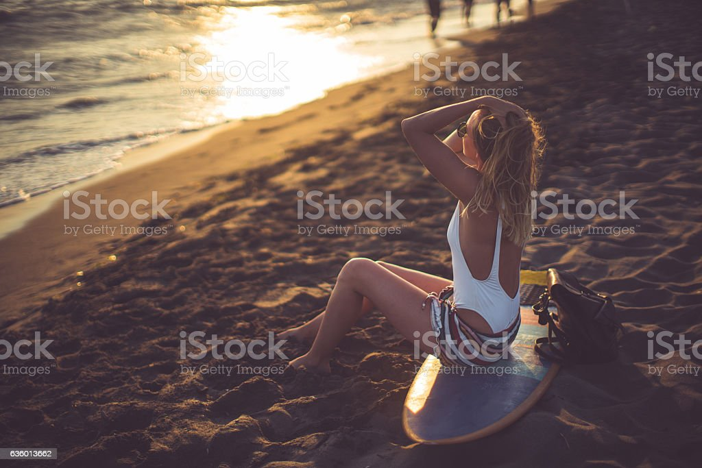 Sunset and a lonely beauty stock photo