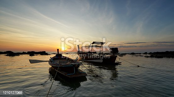 Two boats at Leam Hin, Lanta island, Krabi, Thailand. Background of sunset and beautiful sky and clouds