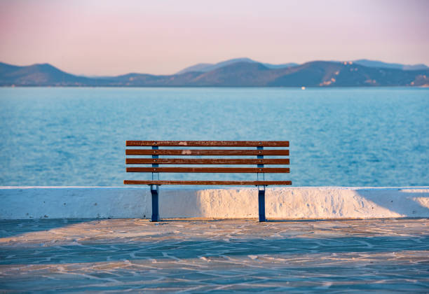 sunset and bench in Rafina city with Aegean sea at the background stock photo