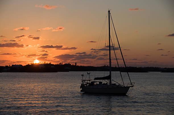 Sunset and Bermuda Sailboat stock photo