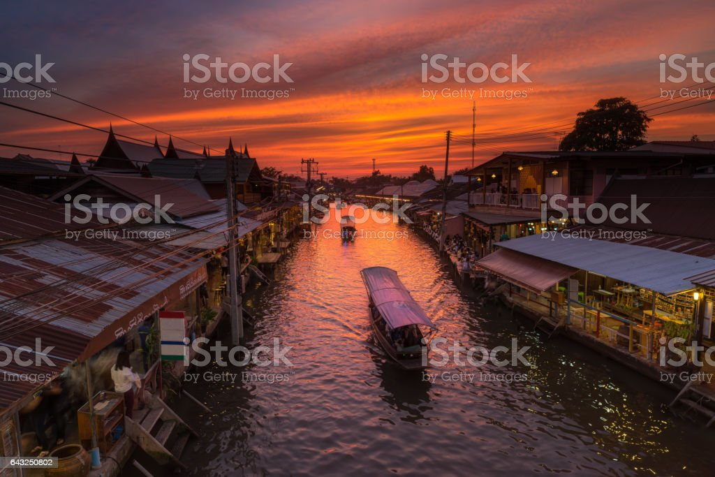 Sunset and Boat on canal with old market stock photo