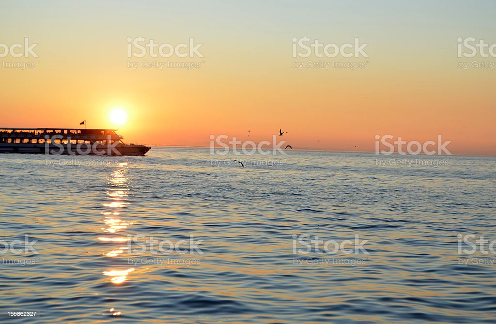 sunset and boat on the sea stock photo
