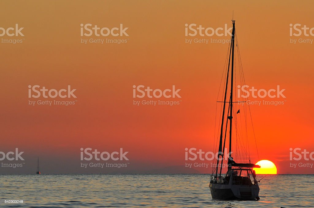Sunset and boat stock photo