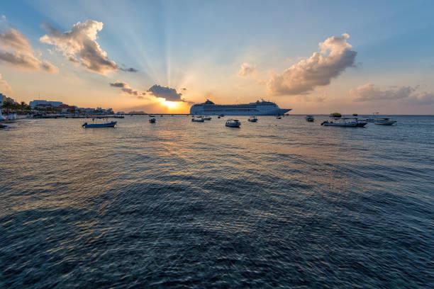 Sunset and cruise ship. stock photo