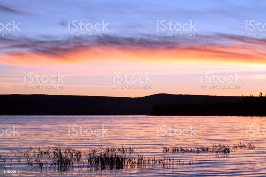 Sunset and dusk on the lake. stock photo