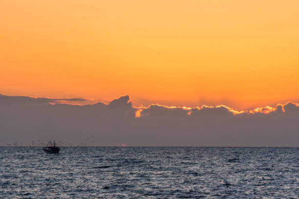 Sunset and Fishing Boats on the Southern Italian Coast - foto stock
