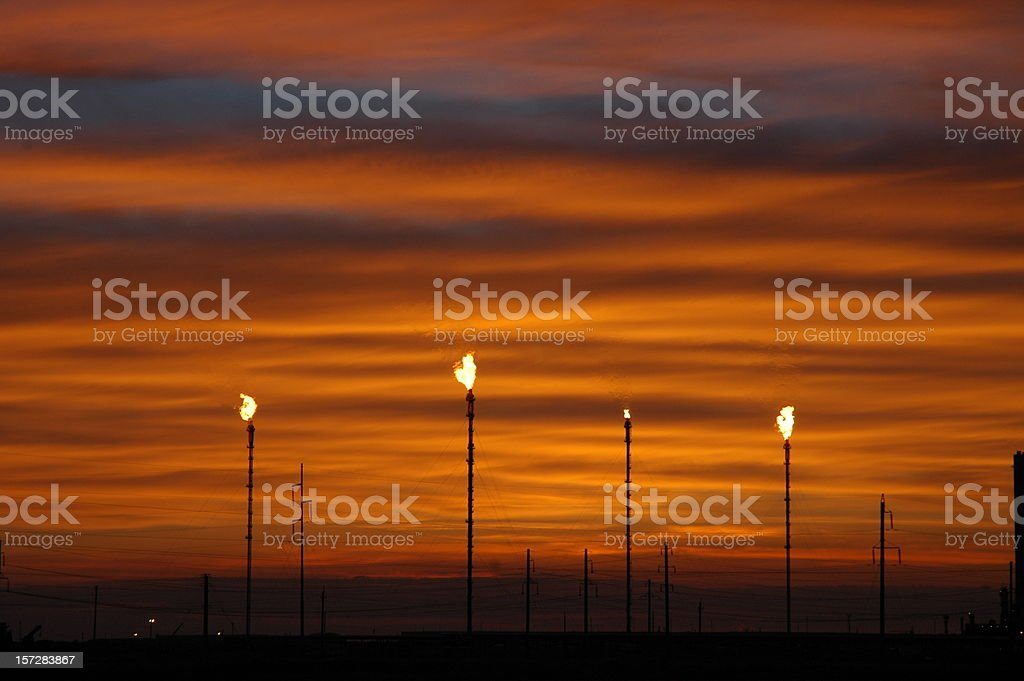 Sunset and Gas Flaring stock photo