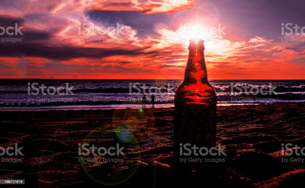 sunset and glass bottle stock photo