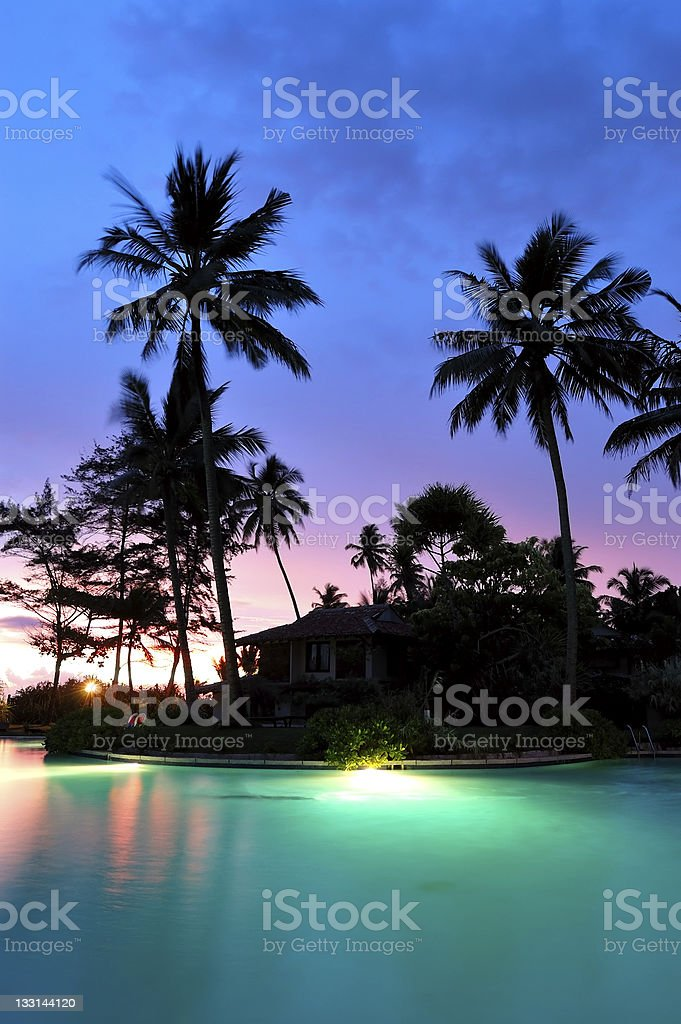 Sunset and illuminated swimming pool, Bentota, Sri Lanka royalty-free stock photo