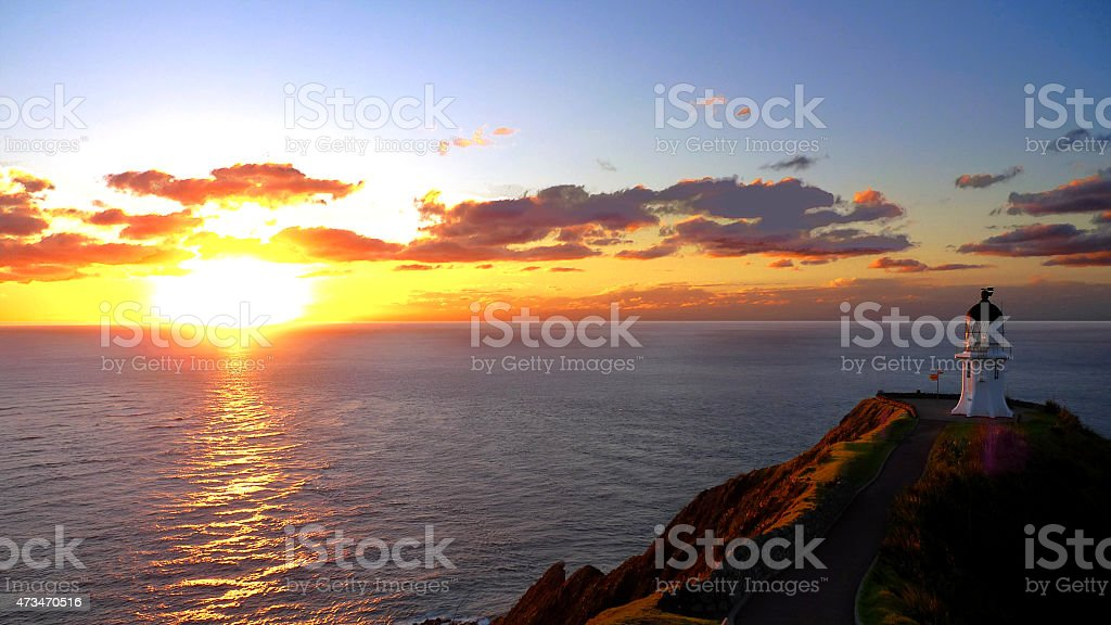 Sunset and lighthouse at Cape Reinga stock photo