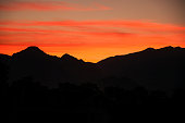 istock sunset and mountain range 498652610