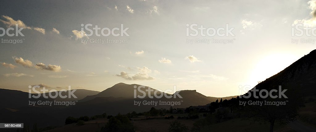 Sunset and mountain silhouette royalty-free stock photo