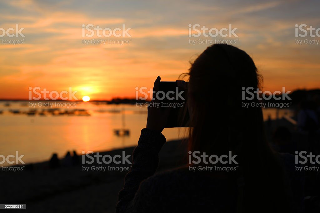 Sunset and photographer zbiór zdjęć royalty-free