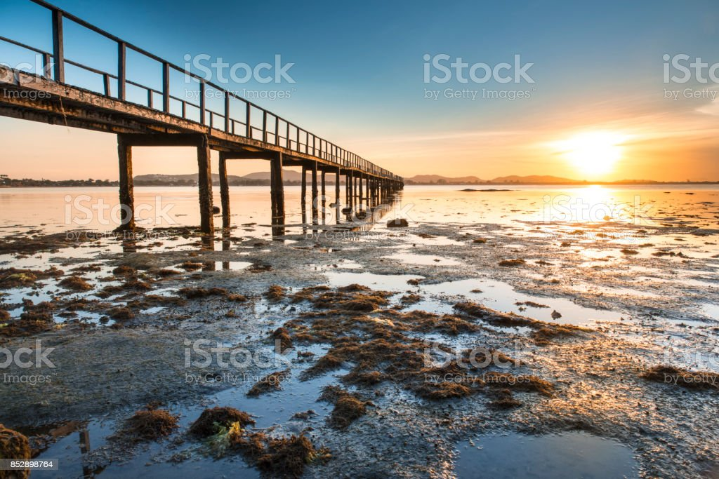 Sunset and pier in Buzios summer stock photo