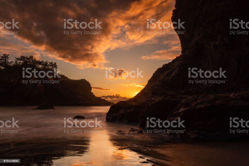 Sunset and Sea Stacks at Secret Beach, Southern Oregon Coast stock photo
