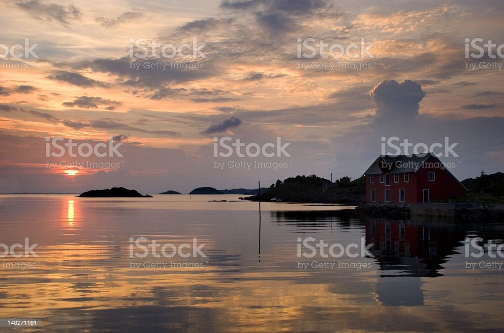 Sunset and seahouse. stock photo