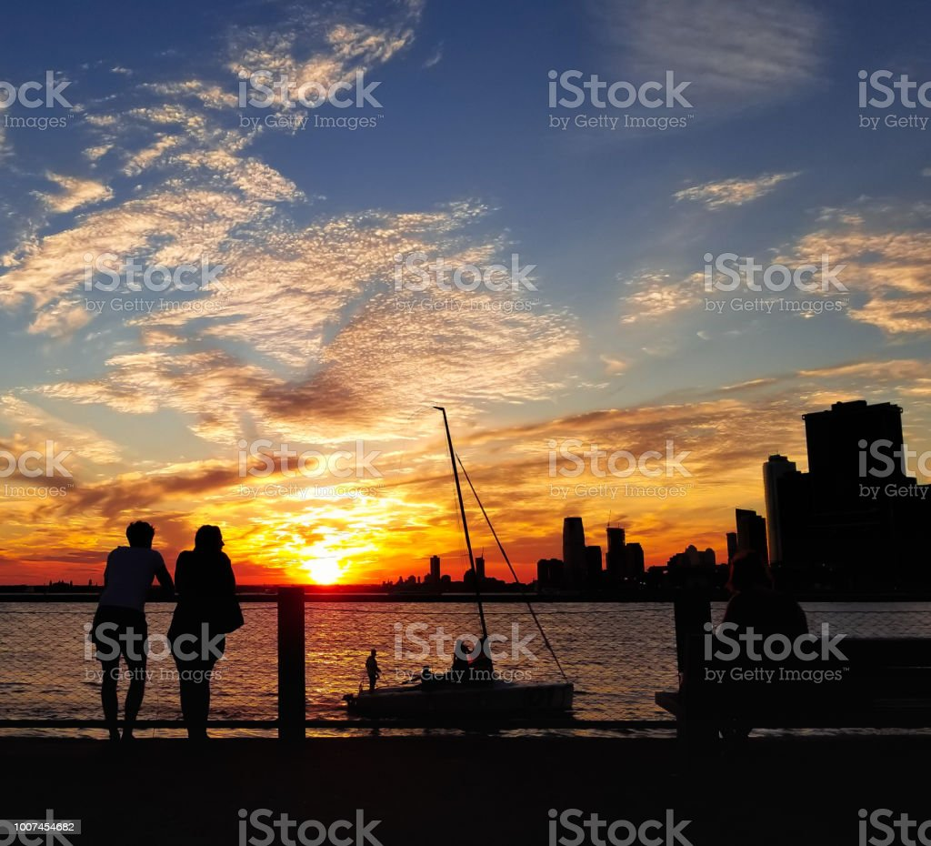 Sunset and Silhouette: Paired to Sail stock photo