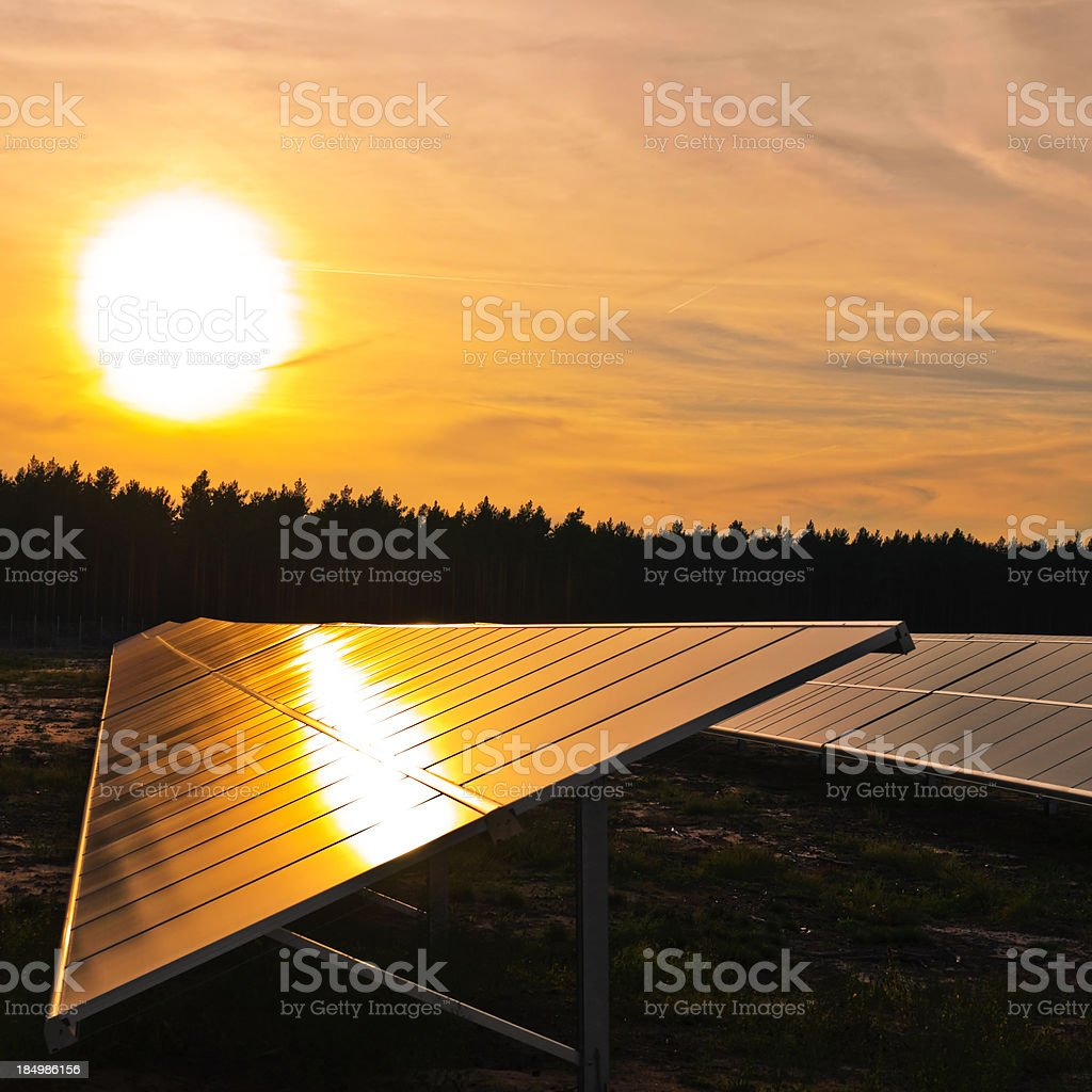 Sunset and solar cell royalty-free stock photo