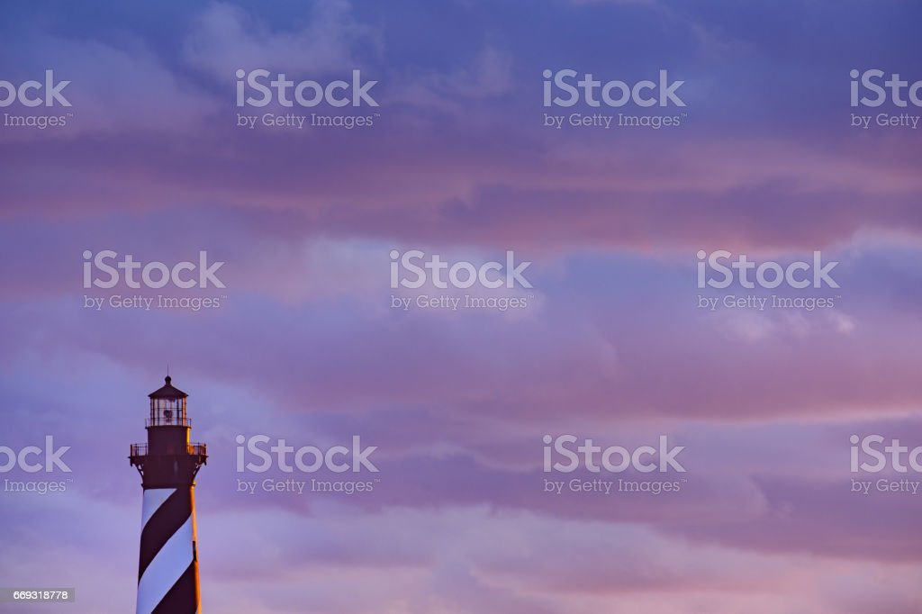 Sunset and spectacular colorful clouds on the gorgeous Cape hatteras Lighthouse on the Outer Banks stock photo