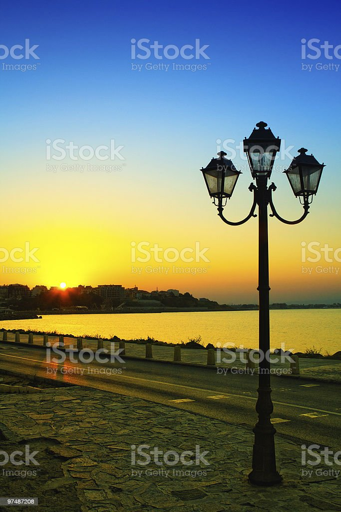Sunset and street lamp in Nessebar, Bulgaria royalty-free stock photo