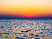 Sunset and sunrise over the sea