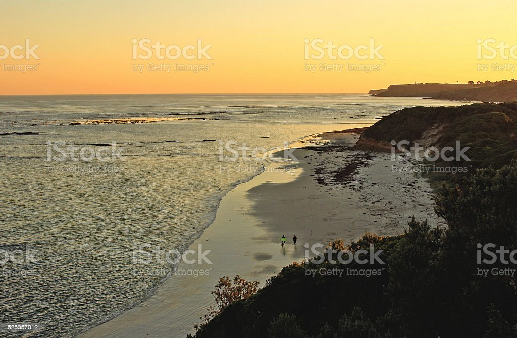 Sunset and surfers stock photo