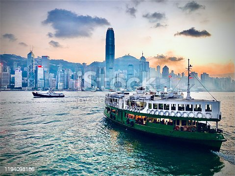 istock Sunset and the Star Ferry in Victoria Harbour, HongKong 1194098186