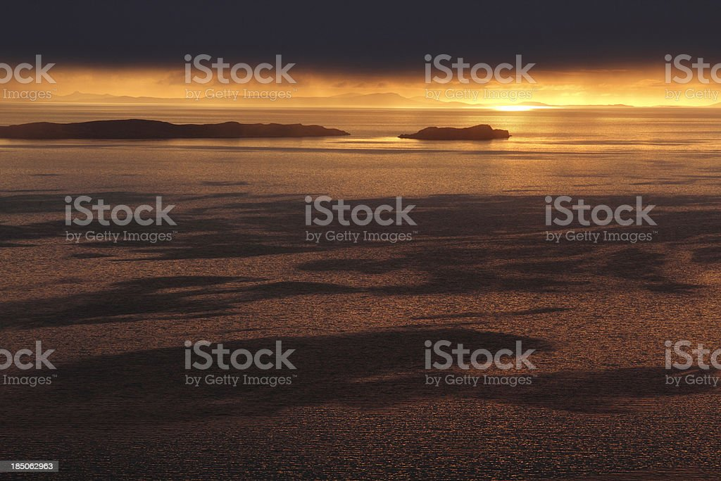 Sunset and water patterns stock photo