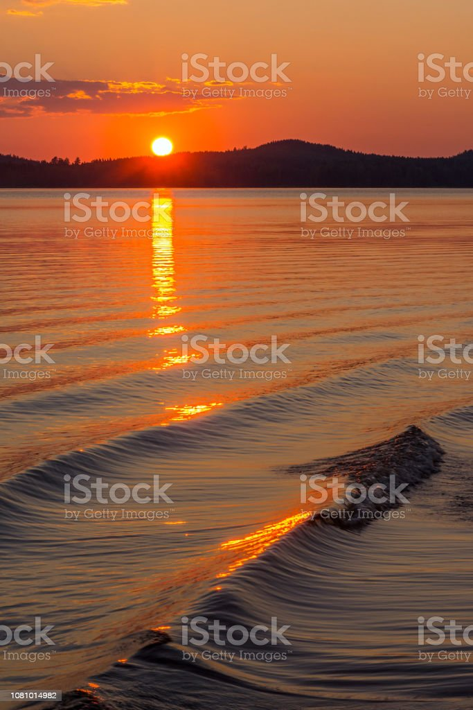 Sunset and wave stock photo