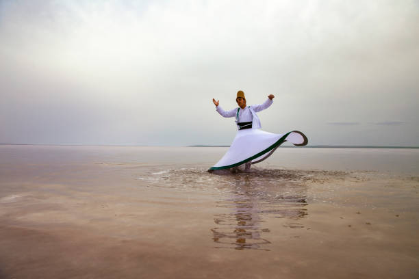 sunset and whirling at the sea, sufi. sufi whirling (Turkish: Semazen) is a form of Sama or physically active meditation which originated among Sufis. stock photo