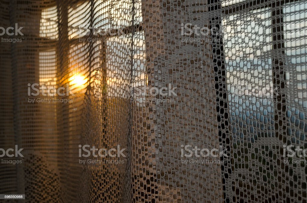 Sunset and window with curtains evening light abstract background royalty-free stock photo