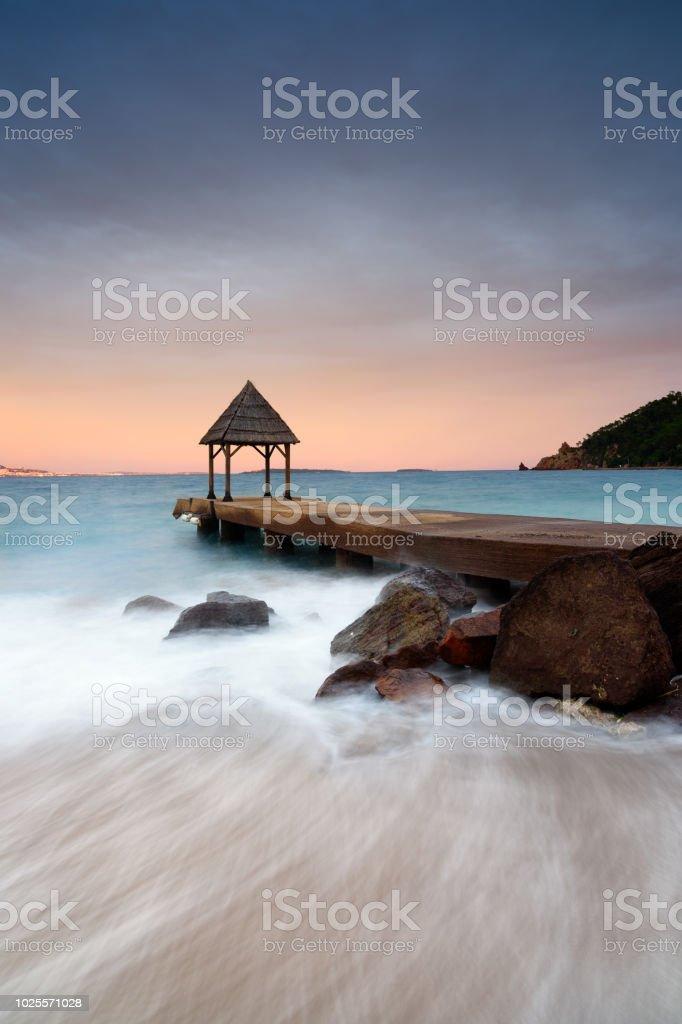 coucher de soleil autour d'une jetée (théoule sur mer) - Photo