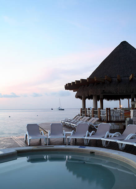 Sunset at a beautiful tropical resort stock photo