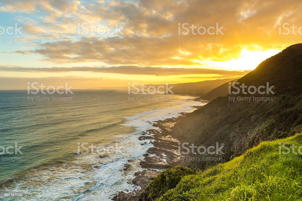 Sunset at a rocky coast stock photo