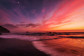 This is a color landscape photo of a vivid sunset over the Pacific Ocean.