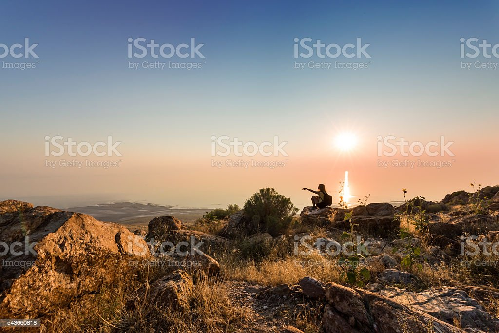 Sunset at Antelope Island in Utah with silhouette of female stock photo