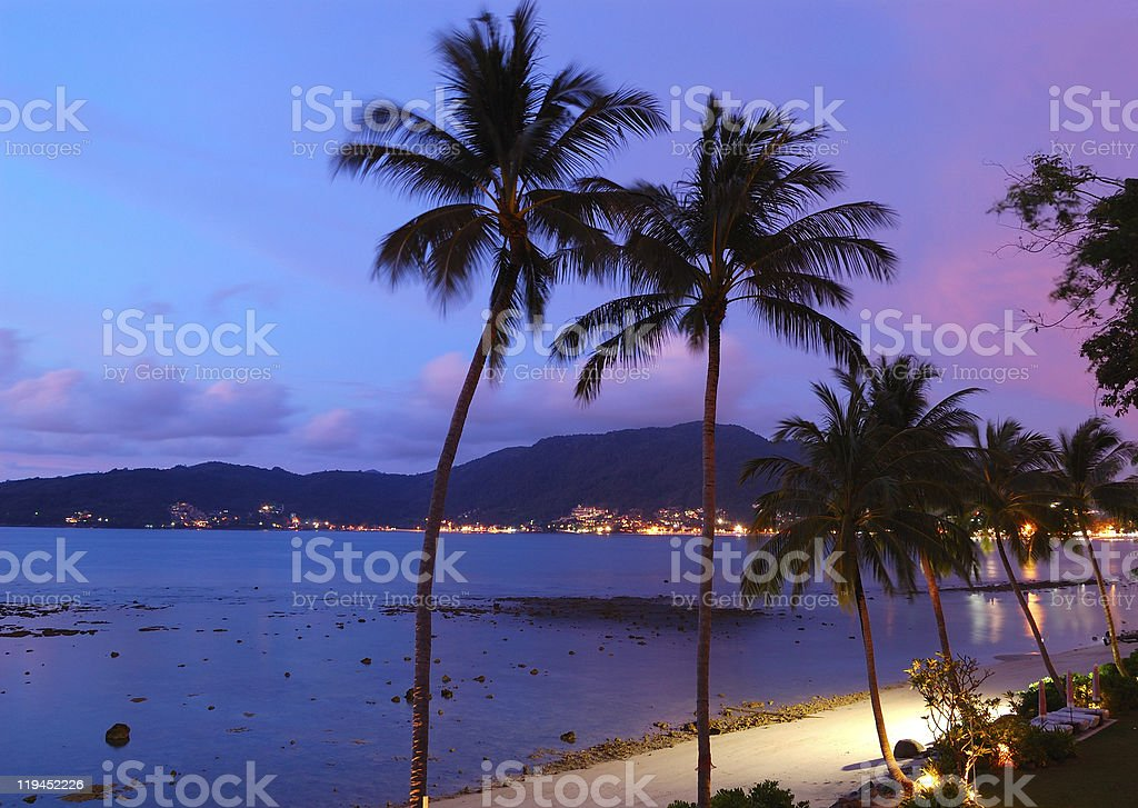 Sunset at beautiful tropical Patong Beach in Phuket Thailand stock photo