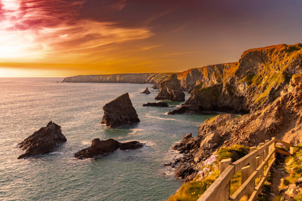 Sunset at Bedruthan Steps in Corwal, United Kingdom stock photo