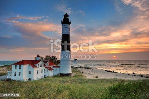 177362898 istock photo Sunset at Big Sable Point Lighthouse - Ludington, Michigan USA 136295475