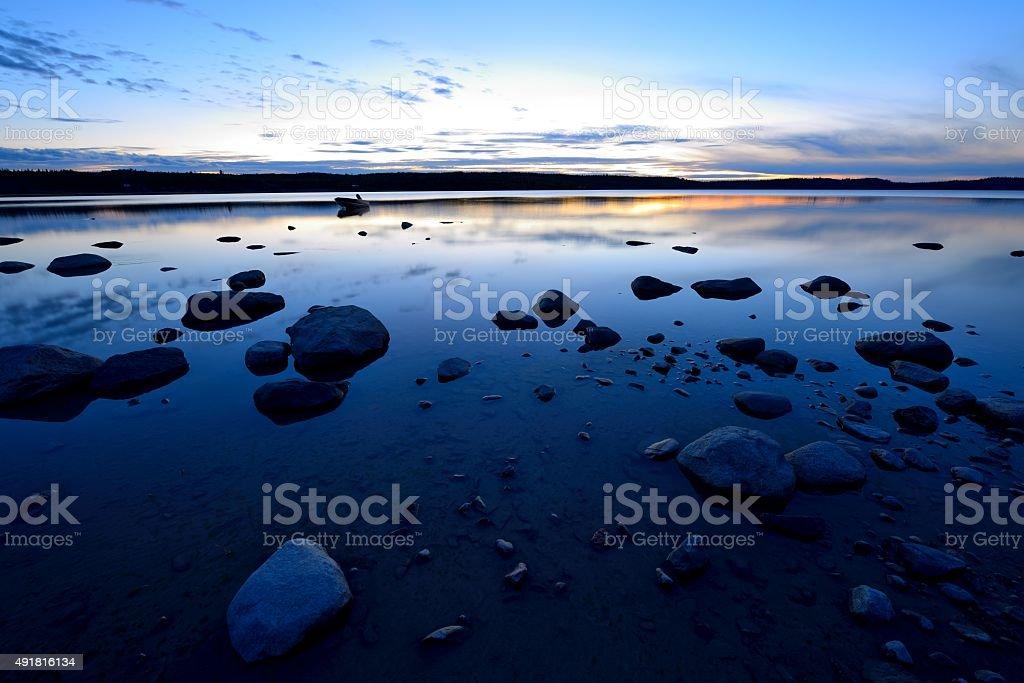 Sunset at Blue Rocky Lake stock photo