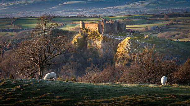 Sunset at Carreg Cennen Castle Carreg Cennen castle sits high on a hill near the River Cennen, in the village of Trapp, four miles South of Llandeilo in Carmarthenshire, South Wales south wales stock pictures, royalty-free photos & images