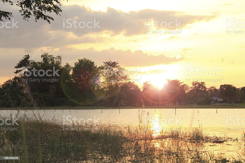 Sunset at coast of the lake with small village royalty-free stock photo