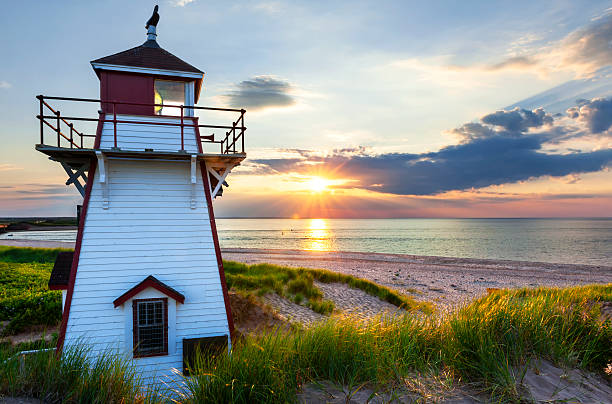 sunset at covehead harbour lighthouse, pei - atlantic ocean stock pictures, royalty-free photos & images