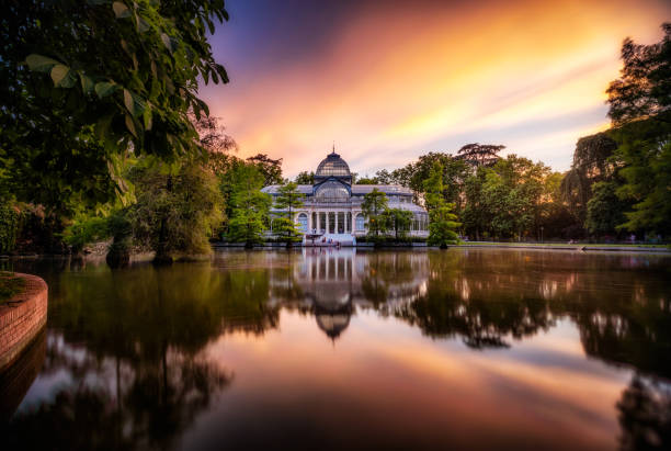 sunset at crystal palace, parque del Buen Retiro park. Madrid, Spain stock photo
