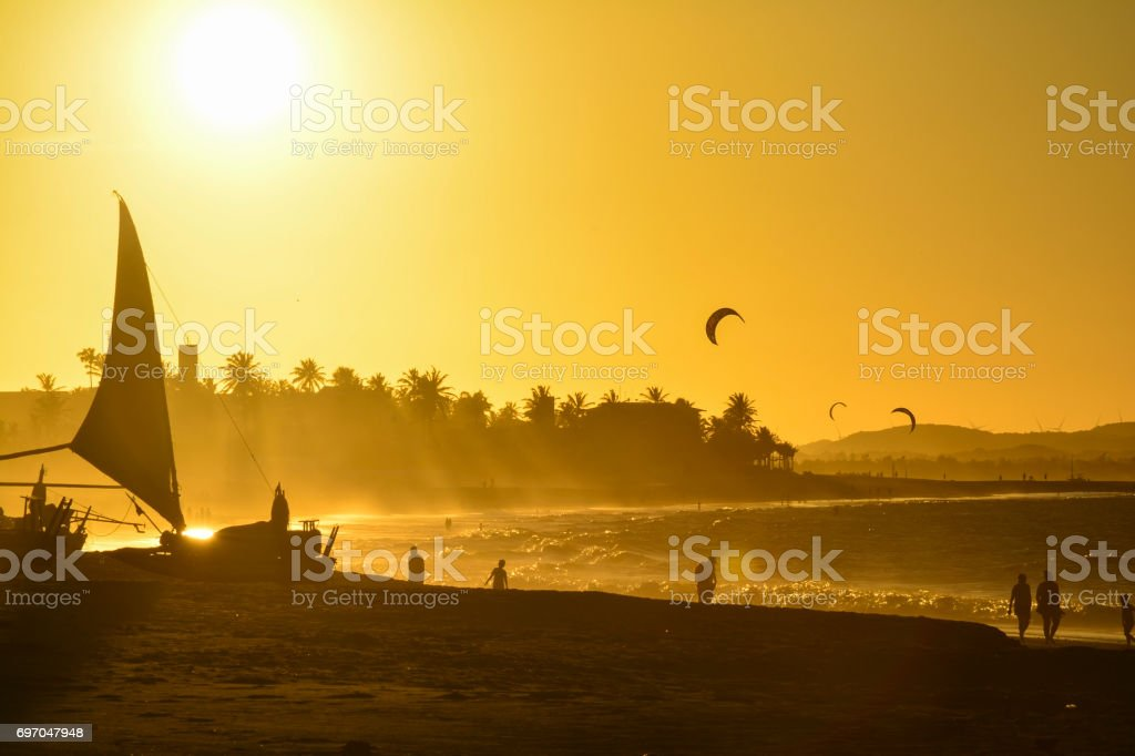 Sunset at Cumbuco Beach. Kite surfers on the sea, Ceara State, Brazil stock photo